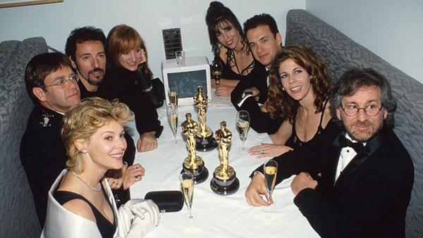 21st March 1994: Kate Capshaw, Elton John, and Bruce Springsteen, Patti Scialfa, Tom Hanks, Rita Wilson and Steven Spielberg at the Elton John AIDS Foundation Party, following the 66th Annual Academy Awards in Los Angeles. (Photo by Kevin Mazur Archive 1/WireImage)
